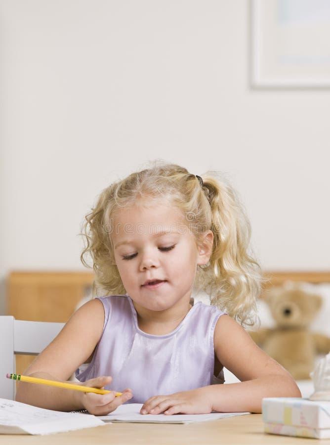 Escritura hermosa de la niña fotos de archivo