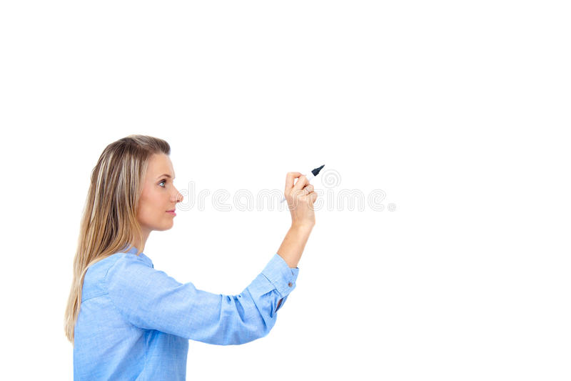Escritura joven de la empresaria con la pluma imagen de archivo