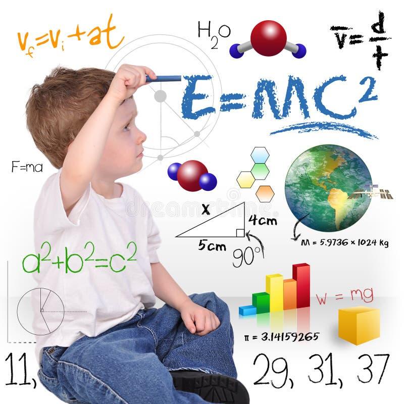 Escritura joven del genio del muchacho de la ciencia de la matemáticas imágenes de archivo libres de regalías