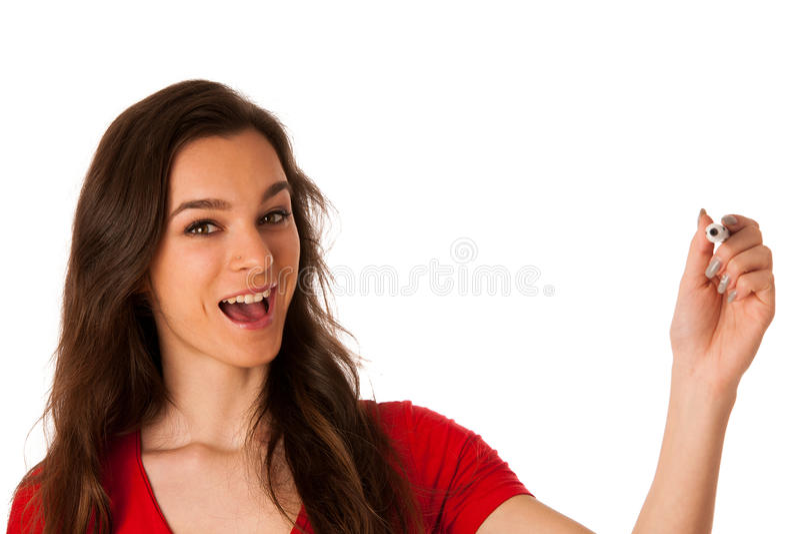 Escritura joven hermosa alegre sonriente feliz de la mujer de negocios o fotografía de archivo libre de regalías