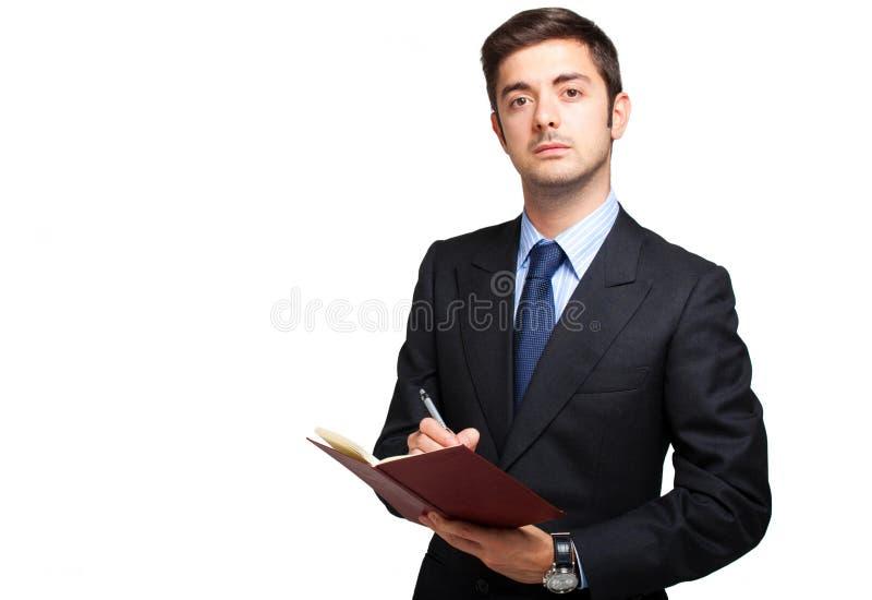 Escritura masculina del encargado en su orden del día fotos de archivo libres de regalías