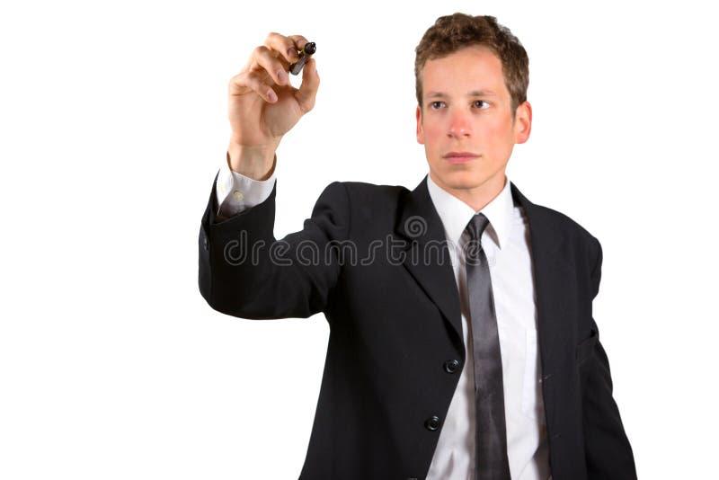 Escritura o dibujo del hombre de negocios con el marcador en la pantalla fotografía de archivo libre de regalías