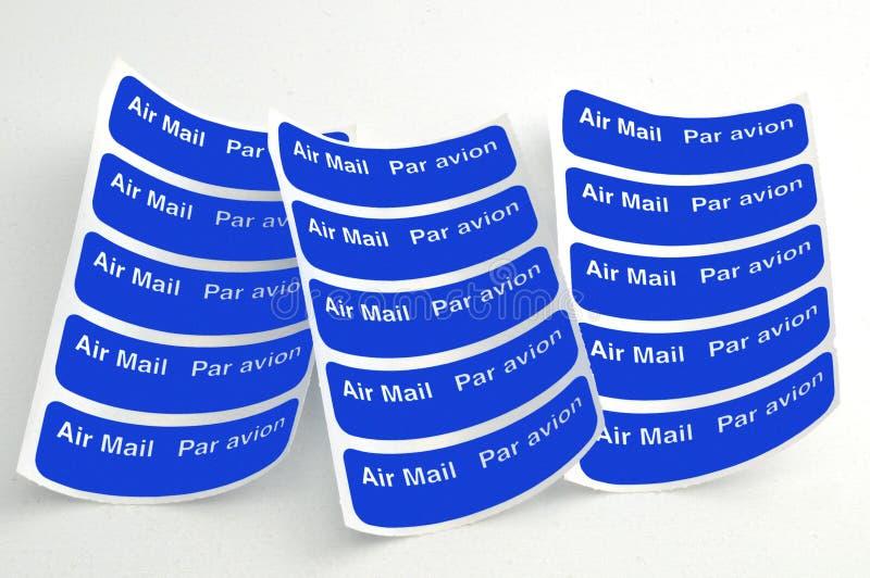 Escrituras de la etiqueta del correo aéreo fotografía de archivo