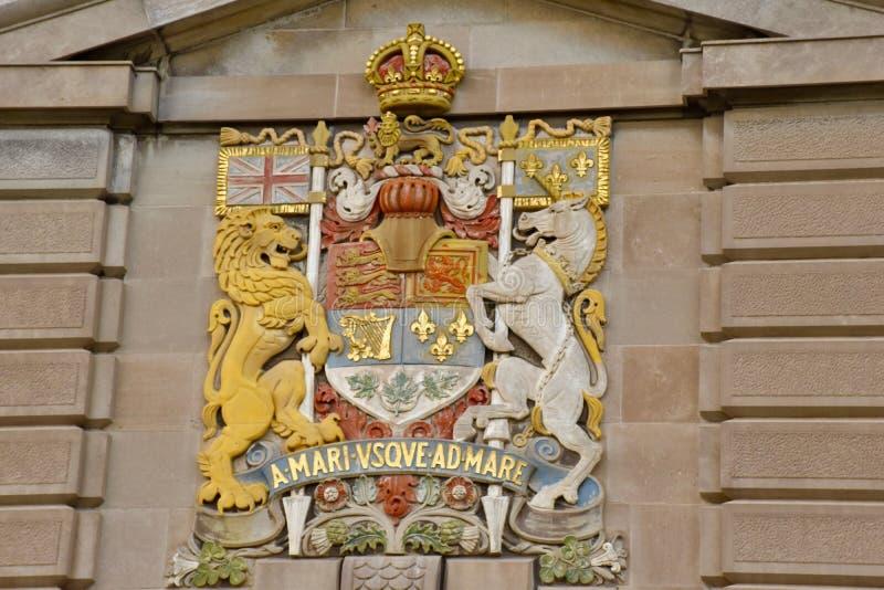 Escudo de armas oficial del ` s de Canadá y lema nacional fotografía de archivo