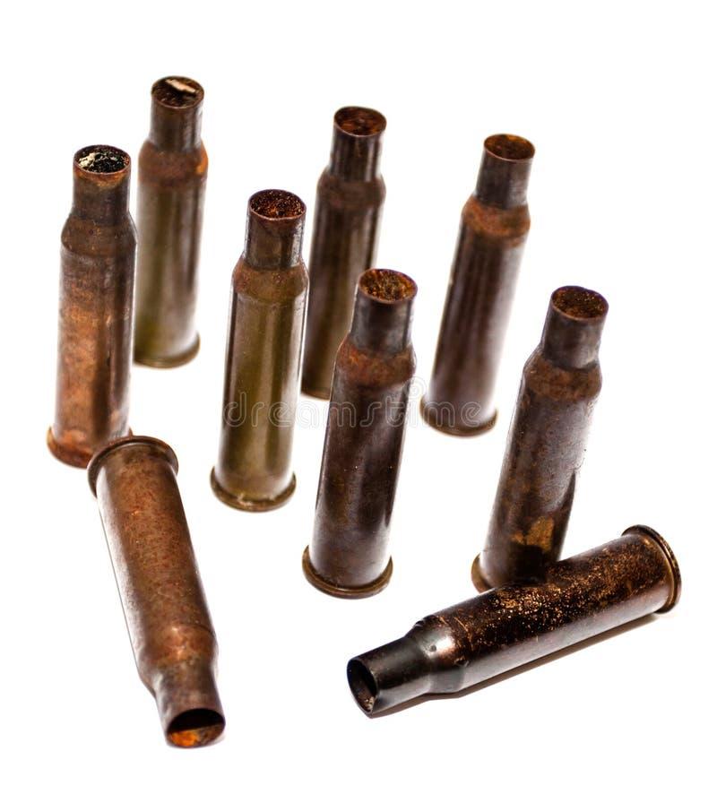 Escudos de uma bala da pilha em um fundo branco fotografia de stock