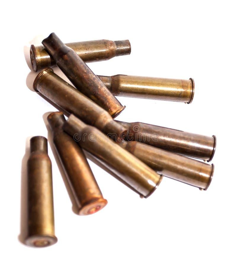 Escudos de uma bala da pilha em um fundo branco imagem de stock
