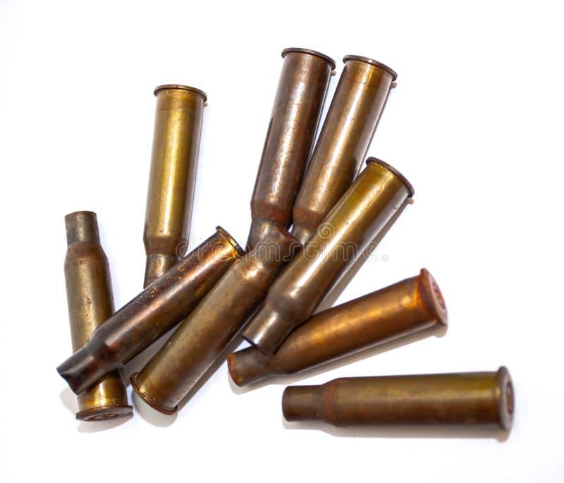 Escudos de uma bala da pilha em um fundo branco fotografia de stock royalty free