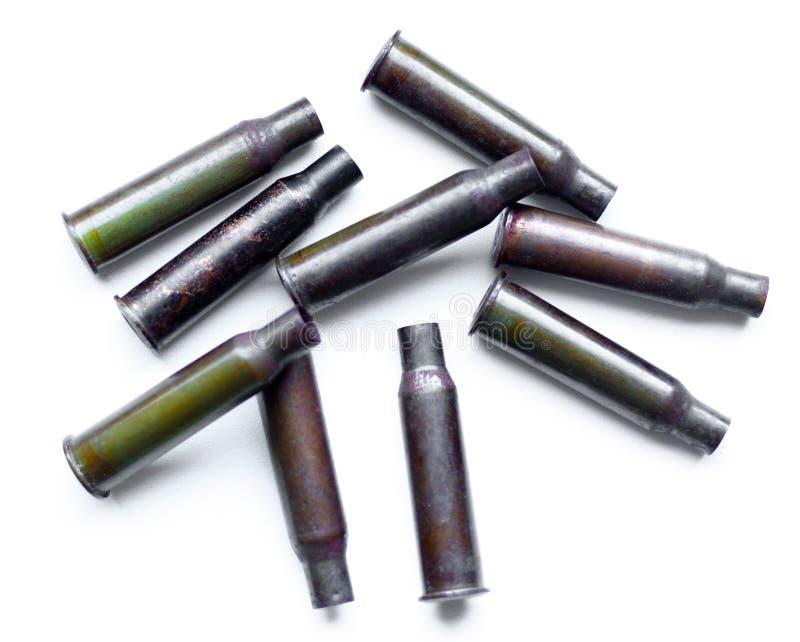 Escudos de uma bala da pilha em um fundo branco imagem de stock royalty free
