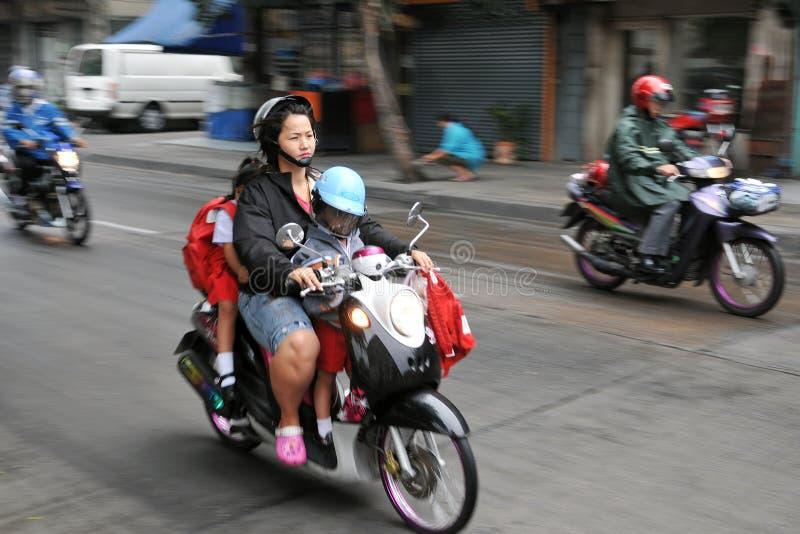 Escuela ejecutada por Motorbike imágenes de archivo libres de regalías