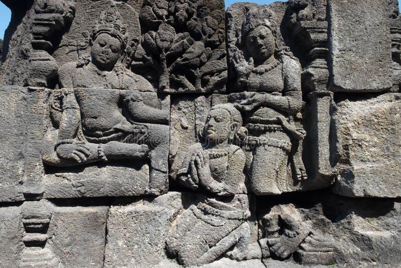 Esculpimento por pedra no templo Borobudur, Magelang, Indonésia imagens de stock royalty free