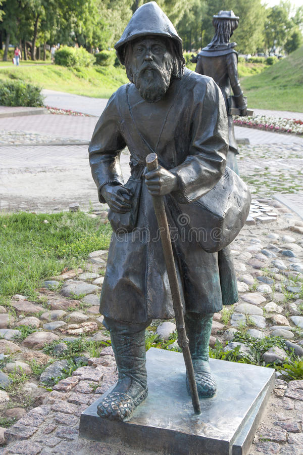 Escultura, campesino con el personal foto de archivo libre de regalías