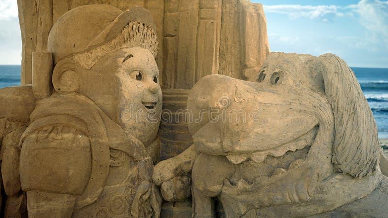 Escultura da areia do filme ascendente fotografia de stock royalty free