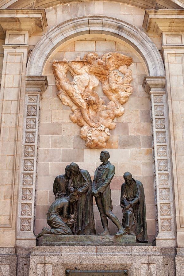 Escultura de bronze de um grupo de homens imagem de stock royalty free