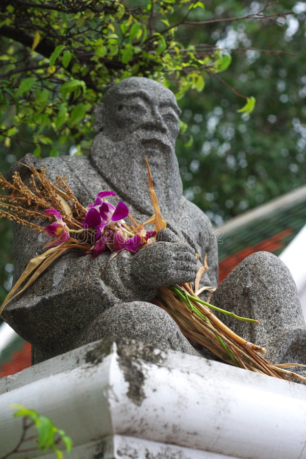 Escultura de pedra budista fotografia de stock royalty free