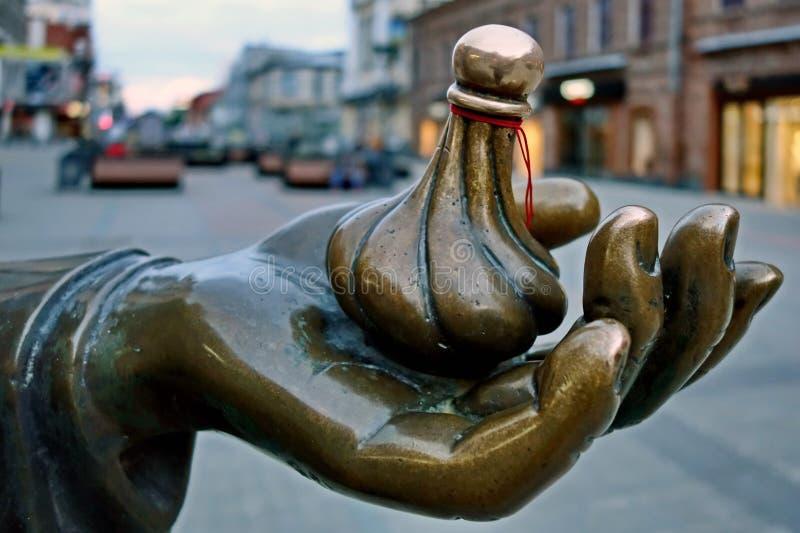 Escultura do fragmento do vendedor ambulante Os cidadãos acreditam que seu vendedor ambulante traz a boa sorte, dinheiro e cumpre imagem de stock