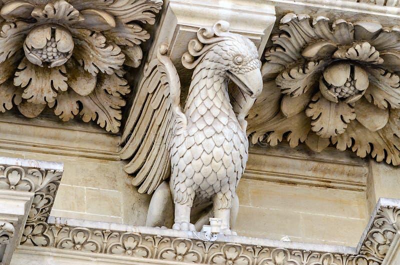 Escultura na igreja da fachada transversal santamente, Lecce foto de stock
