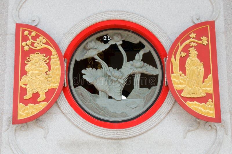 Escultura nativa do chinês no indicador de madeira foto de stock royalty free