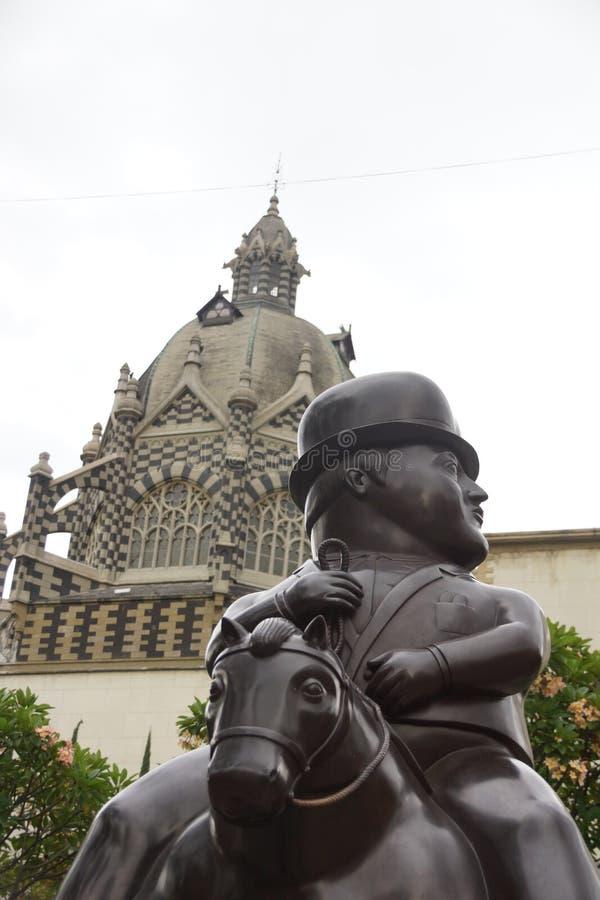 Escultura para a casa da cultura em Medellin Colômbia imagens de stock royalty free