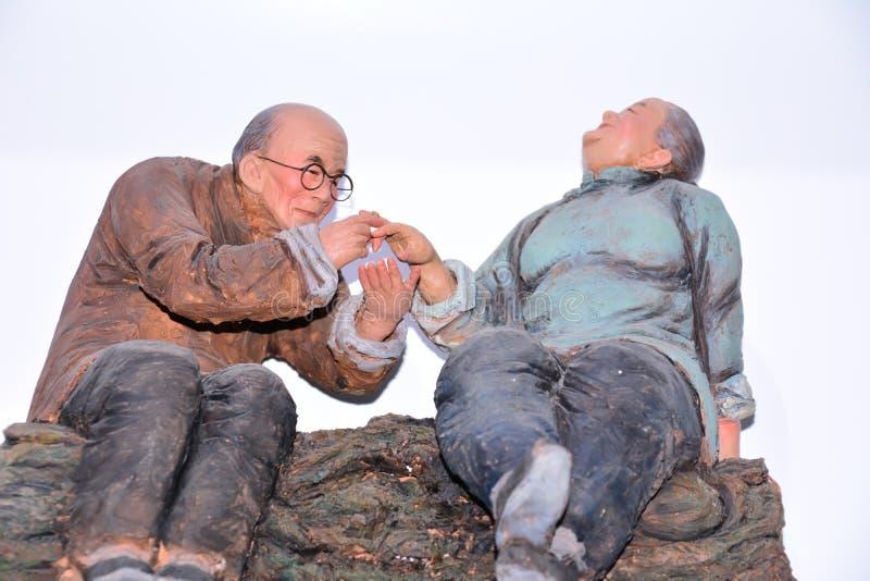 A escultura pintada dois anciões fotos de stock royalty free