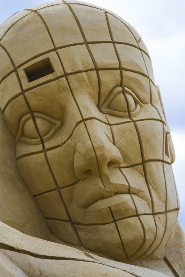 Escultura principal estrangeira da areia foto de stock