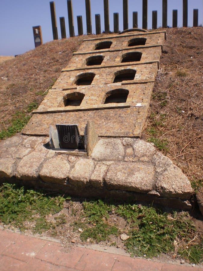 Esculturas por motivo de la restauración del faro fantástico del siglo de Roman Lighthouse Of The First en el mundo en La fotos de archivo libres de regalías