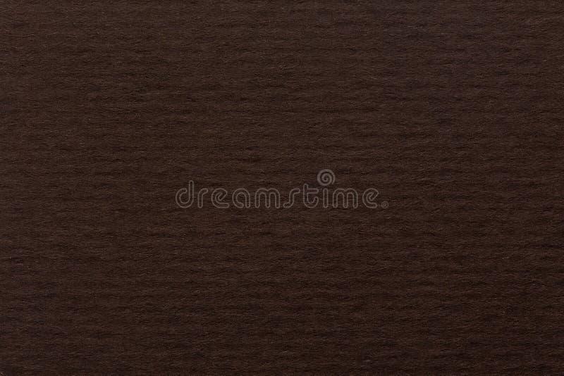 Escureça o papel marrom para o fundo no macro para seu projeto imagens de stock