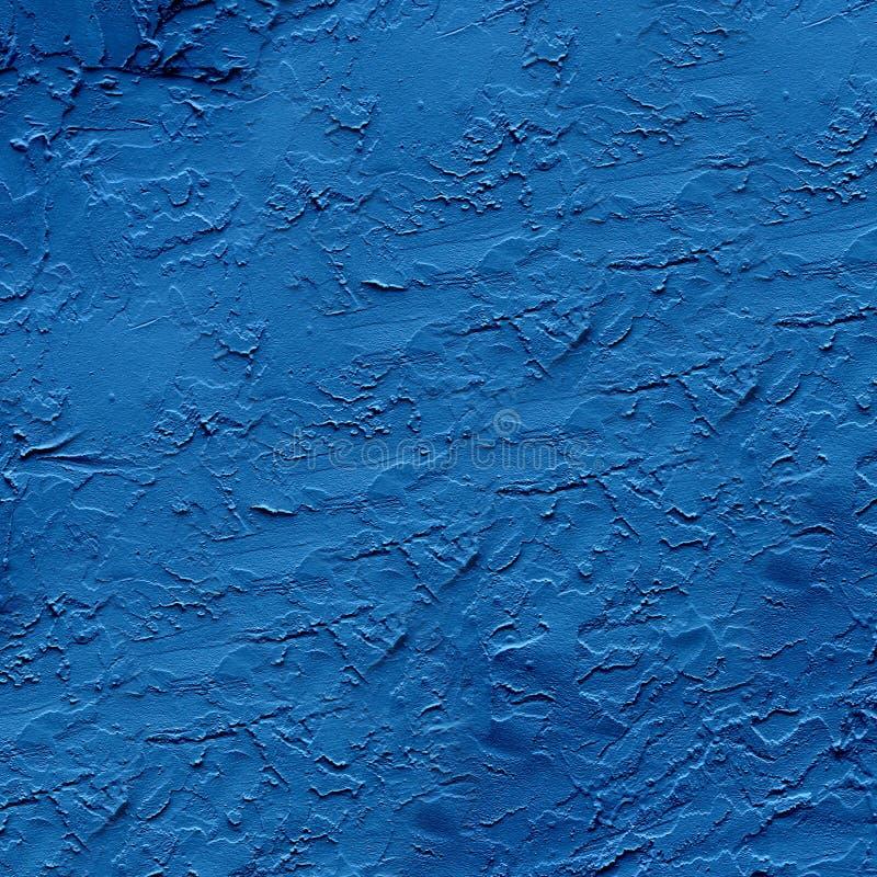 Escuro áspero - emplastro azul aplicado à superfície da parede foto de stock royalty free