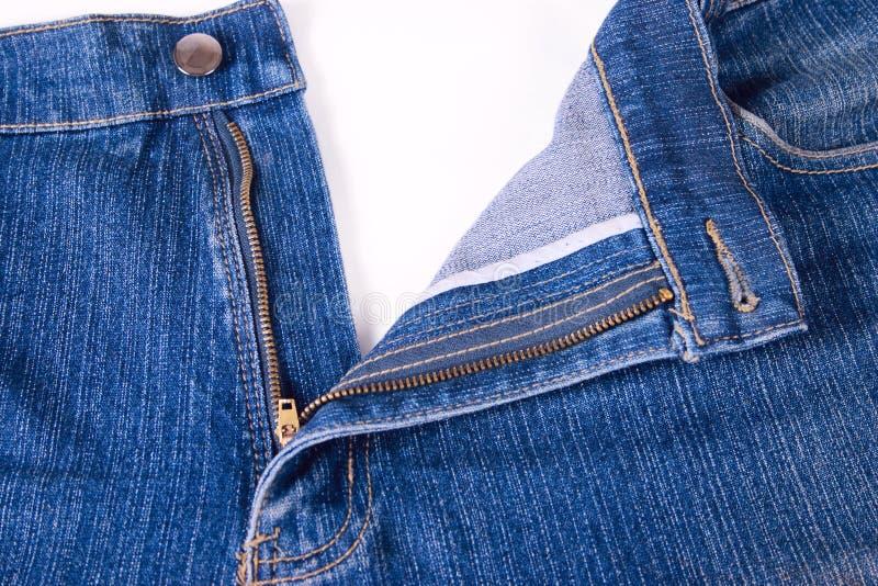 Escuro - calças de ganga com uma mosca aberta fotos de stock