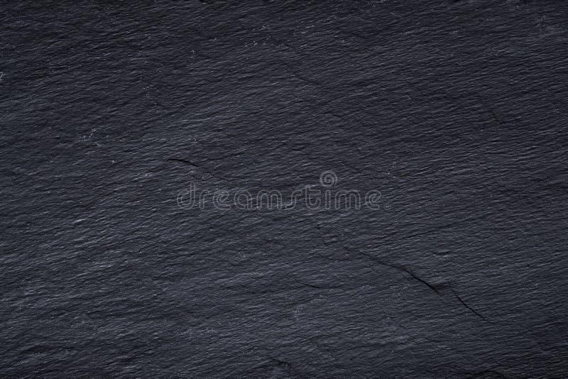 Escuro - fundo da ardósia ou textura preta cinzenta da pedra natural imagem de stock