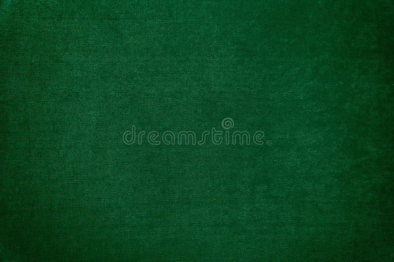 Escuro - fundo verde da textura de veludo imagens de stock