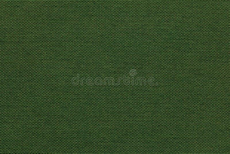 Escuro - fundo verde de um material de matéria têxtil com teste padrão de vime, close up imagens de stock royalty free