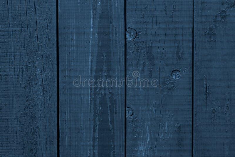 Escuro - superf?cie de madeira ?spera azul Placas de madeira azuis Fundo de madeira da textura da prancha Escuro - tabela de made foto de stock