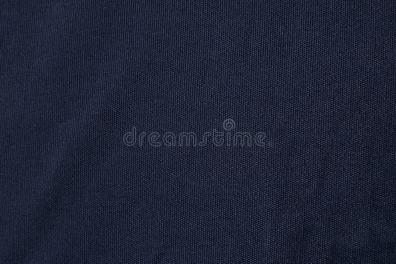 Escuro - textura azul da tela da lona Fundo vazio do teste padrão de matéria têxtil de algodão imagens de stock