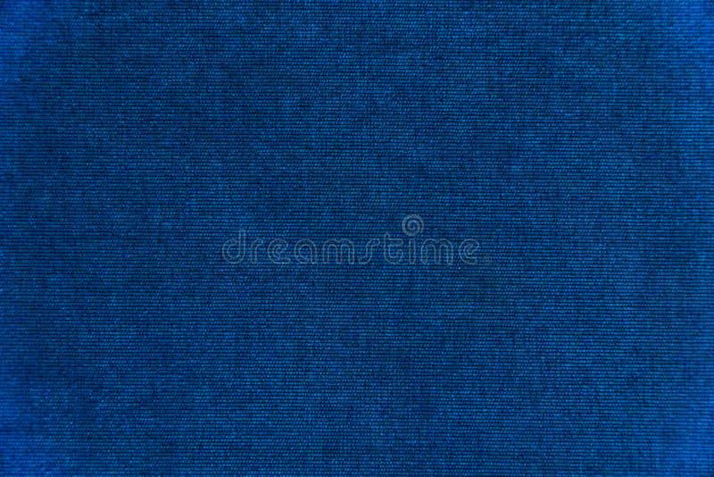 Escuro - textura azul do fundo de veludo imagens de stock royalty free