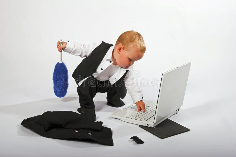 Esecutivo del bambino che pulisce fotografie stock