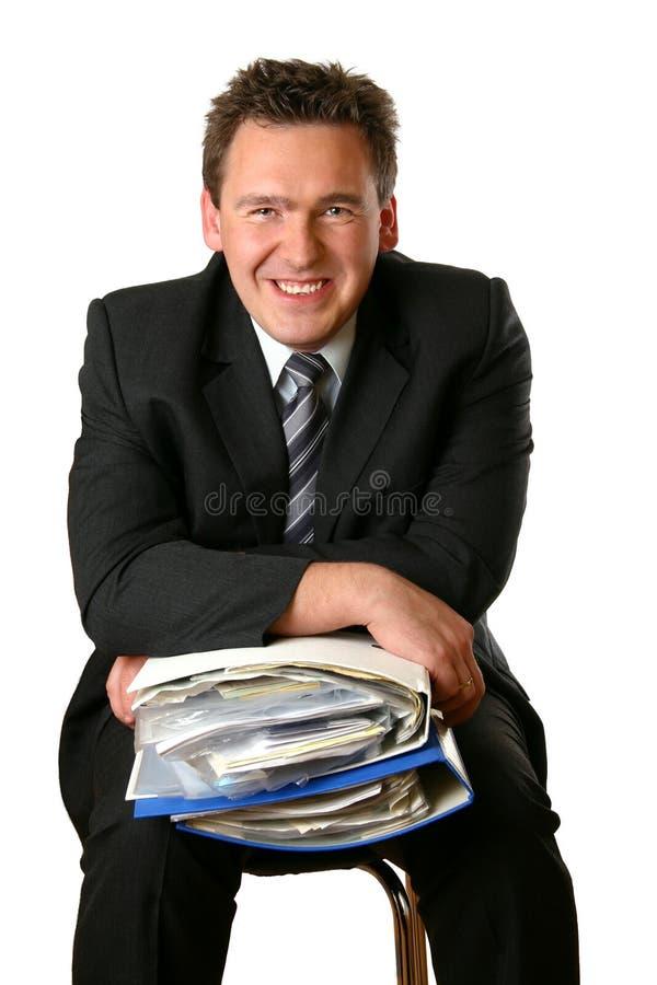 Esecutivo ed i suoi documenti fotografia stock
