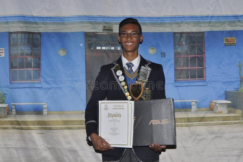 Esecutore della cima di Guillieano Prinsloo nel grado 12 alla High School di Uitenhage fotografie stock