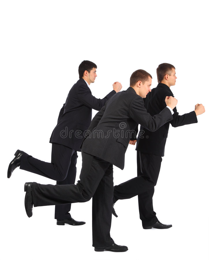 Esecuzione dei tre una giovane uomini d'affari, vista laterale immagine stock