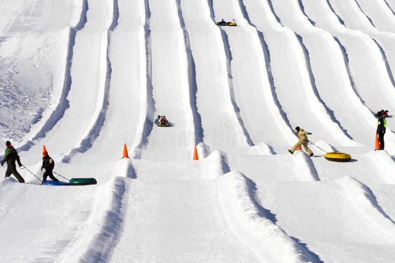 Esecuzioni della tubazione della neve della casetta del pattino fotografia stock