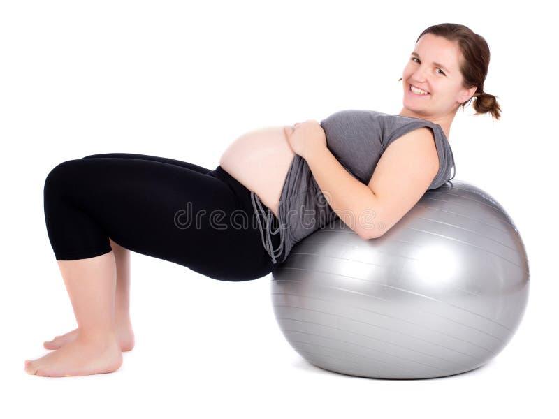 Esercitazione della donna incinta fotografia stock