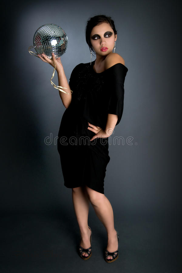 Esfera asiática 'sexy' do disco da terra arrendada da menina fotografia de stock