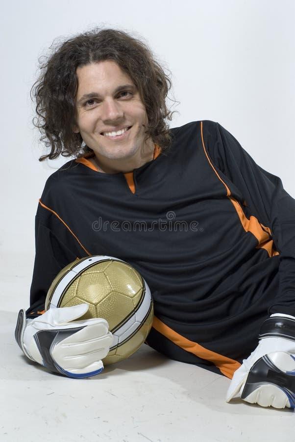 Esfera da terra arrendada do jogador de futebol fotos de stock royalty free