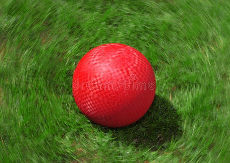 Esfera de campo de jogos vermelha imagem de stock