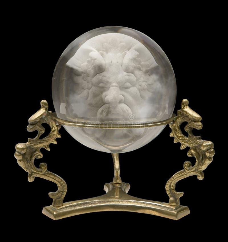 Esfera de cristal com uma face do feiticeiro imagem de stock royalty free