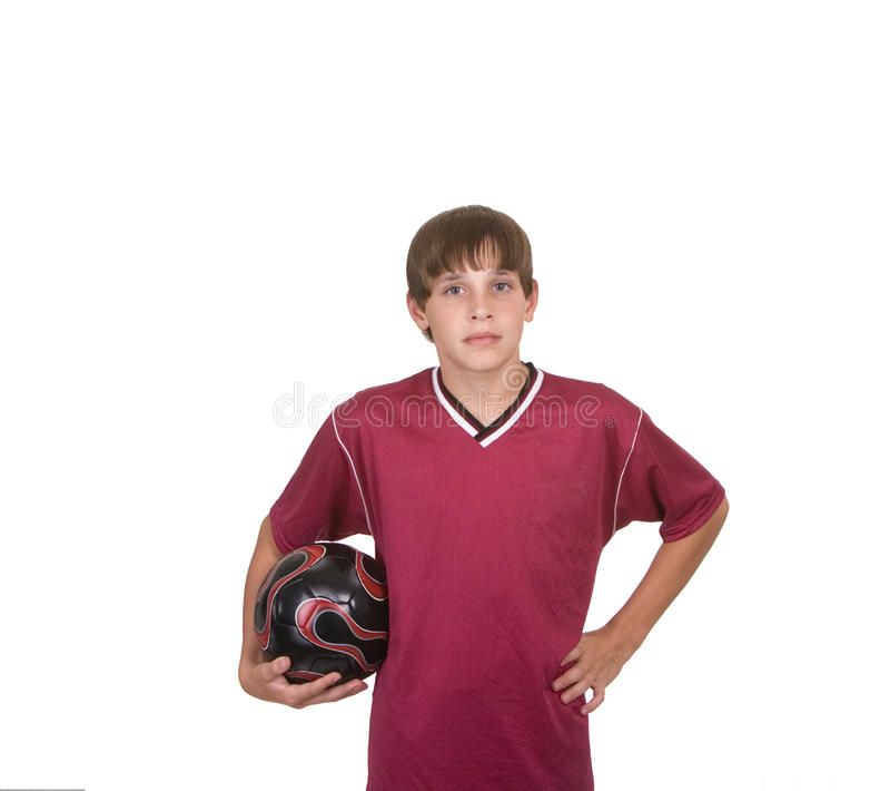 Esfera de futebol da terra arrendada do menino imagens de stock
