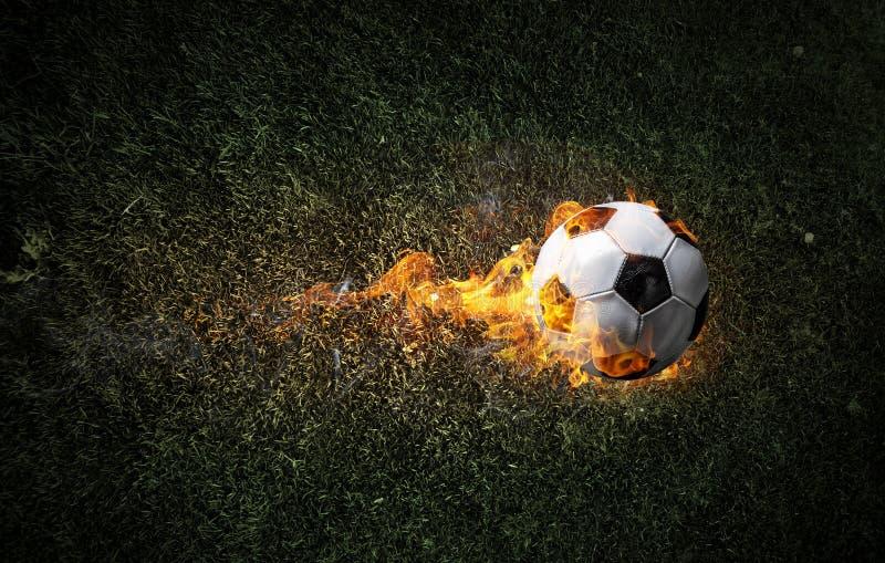 Esfera de futebol no incêndio imagem de stock