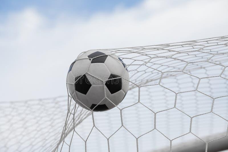 Esfera de futebol no objetivo imagem de stock royalty free