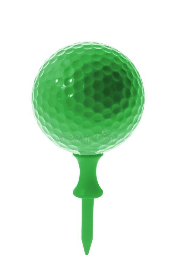 Esfera de golfe verde no T imagens de stock royalty free