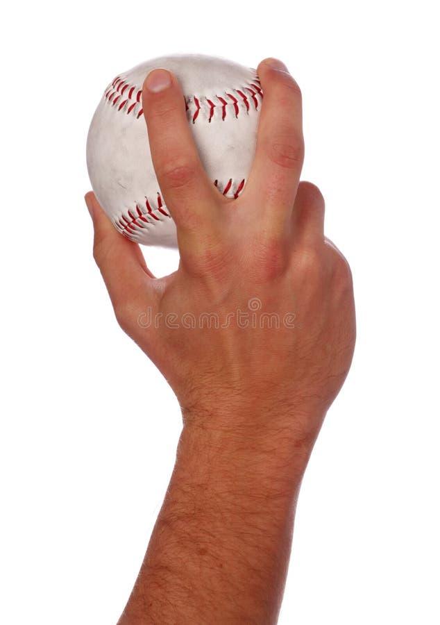 Esfera de jogo do softball do homem fotos de stock royalty free
