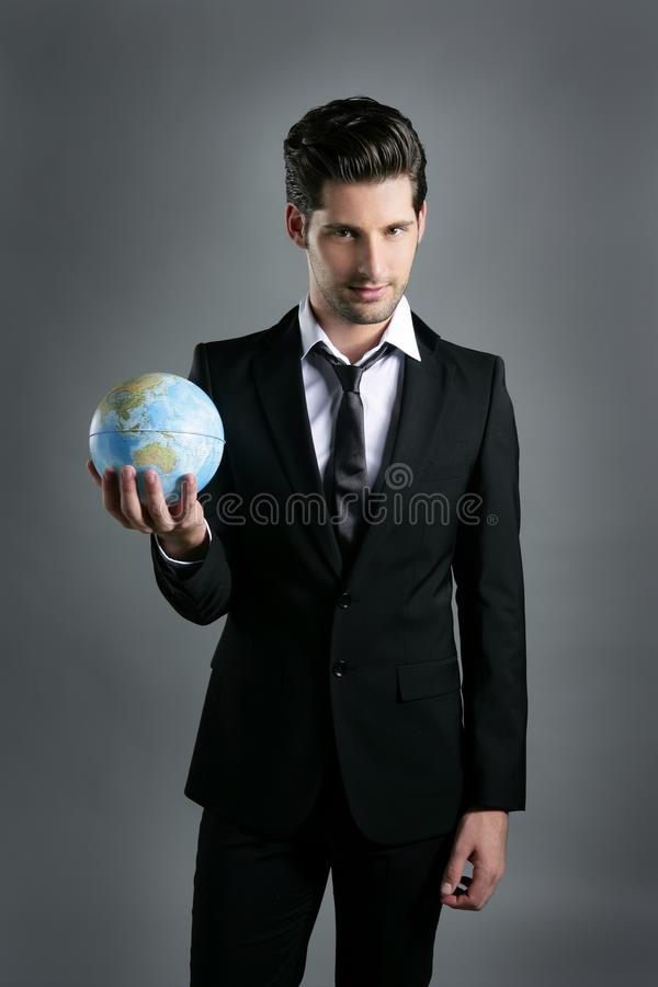 Esfera do mapa do globo do mundo na mão do homem de negócios imagens de stock royalty free
